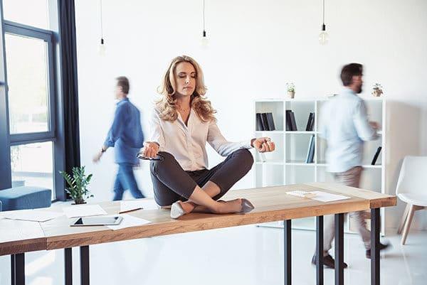 Meditating business woman